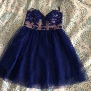 A blue sparkly formal dress